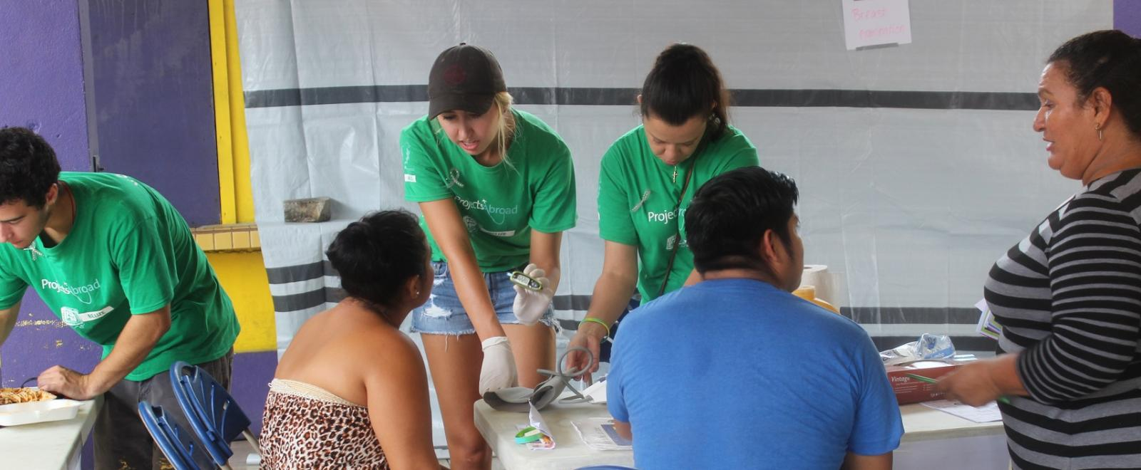 Three Projects Abroad Public Health Interns give health checks to locals in Belize